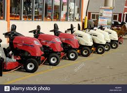 Pattern of lawn mowers in front of a home hardware store Home