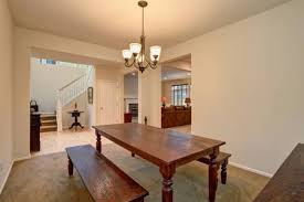 Open Floor Plan View Of Dining Room With Carved Wooden Table Living And