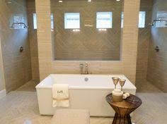a carrara marble tile inlay really makes this girly bathroom
