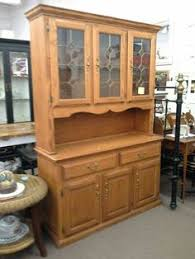 sold this locking curio cabinet is oak and has green accents