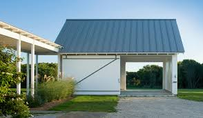 Luxury garage doors garage contemporary with tall grasses white