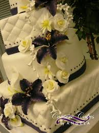 Cascading down the tower of cake were beautiful sugar flowers including deep purple tiger lilies white calla lilies roses daisies