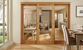 Brown Wooden Sliding Glass Interior Doors Between Kitchen And Dining Room