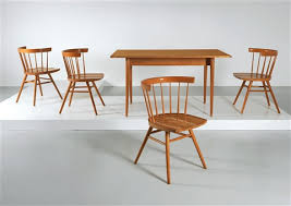 A Dining Room Suite Of Furniture By George Nakashima
