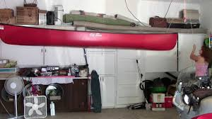 Garage Ceiling Kayak Hoist by How To Hang A Canoe From The Ceiling Youtube