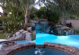 Lagoon Pool With Spa, Grotto Waterfall, And Fire Pit | Lucas Lagoons Stunning Cave Pool Grotto Design Ideas Youtube Backyard Designs With Slides Drhouse My New Waterfall And Grotto Getting Grounded Charlotte Waterfalls Water Grottos In Nc About Pools Swimming Latest Modern House That Best 20 On Pinterest Showroom Katy Builder Houston Lagoon By Lucas Lagoons Style Custom With Natural Stone Polynesian Photo Gallery Oasis Faux Rock 40 Slide