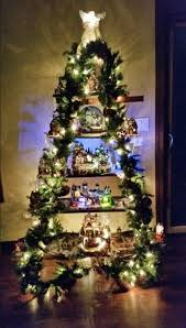 There Are So Many Ways To Display A Snow Village And One Creative Way Is Using Ladder Join Two Ladders Wrap Them With Garland Lights