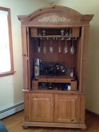 make mine a double old tv armoire tuned into a bar