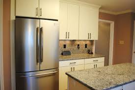 White Rohe Cabinets Stainless Appliances Kitchen