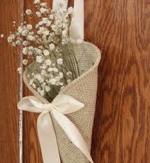 Rustic Burlap Wedding Decorations With White Flowers In Cone Vase Hanging On Wooden Fence