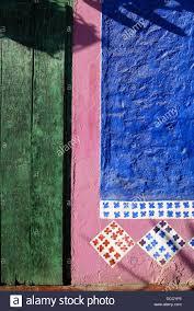 Colorful exterior of Mi Casa restaurant green door blue and pink