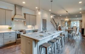 Open Kitchen To Dining Room Concept With Tundra Gray Marble Counter