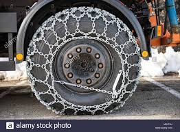 Truck Wheel With The Snow Chains Stock Photo: 175211166 - Alamy
