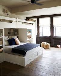 modern full over queen bunk bed with drawer storage and staircase