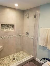 beautiful shower remodel using sliced sea green and white pebble