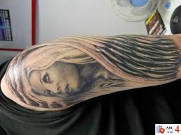 Face Of An Angel With Wing Wrapped Around Scene Tattoo