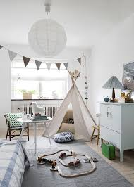 Beautiful Bright And Airy Nursery With Dramatic Light Fixture Large Windows Lots Of Natural Charming Scandinavian House Shaped Bed