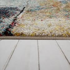 wohnzimmer teppich stein optik rauten muster bunt mirai