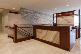 Reception Desk And Partition In ViviStone Cream Onyx Glass With Pearlex Finish At Burr Forman Orlando Florida