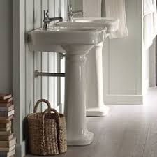 the bold look of neutral bathroom faucets and white bathrooms