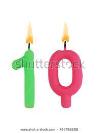 Burning birthday candles isolated on white background number 10