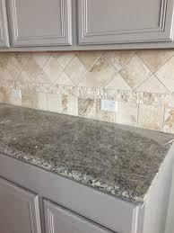 gray kitchen cabinets travertine backsplash santa cecilia light