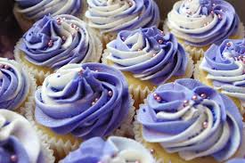 vanilla cupcakes creme caramel secret centres purple and white vanilla butter icing