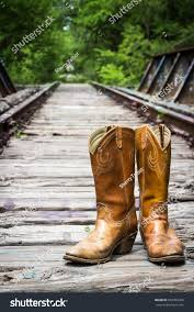 Cowboy Boots On Old Railroad Trestle Stock Photo 603393209 ... Woods Boots Texas Cowboy Image Browser Boot Barn Employee Robbed Of 22k At Gunpoint In Parking Lot Rebel By Durango Saddle Up Mens Tan And Brown Western These Artisans Deserve A Tip The Hat Las Vegas Reviewjournal Outback Trading Co Womens Black Santa Fe Vest 9 Best Holiday Wish List Images On Pinterest Cowgirl Amazoncom Cotswold Sandringham Buckleup Wellington Designer Concealed Carry Grey Hobo Bag On Old Railroad Trestle Stock Photo 603393209 47 Whlist Children