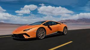 The Image Shows Detail Of Tail Light An Orange Huracan Performante And Part Rear Spoiler