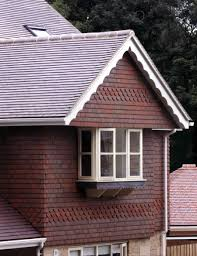 blue brindle and plain clay roof tiles