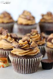 Chocolate Peanut Butter Cupcakes Topped With Frosting And Cups