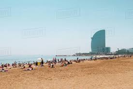 100 The W Barcelona Tourist Relaxing At Beach By Hotel Against Clear Sky Stock Photo