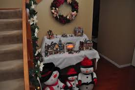 As You Enter Our Home Are Greeted By Mr Bs Christmas Village The Pieces Lemax And St Nicholas Square Sweet Stuffed Caroling Snowman Family