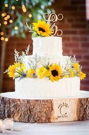 Sunflower Wedding Cake With Wood Tree Slice Base