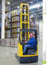 The Driver Of A Forklift Pallet Truck, Reach Trucks. Editorial ... Reach Trucks Vetm 4216 Jungheinrich Total Forklift Truck Stand On Narrow Aisle Nissan Gb Wikipedia Trucks Store Logistic Warehouse Industry Linde Reach Forklift Reset Productivity Benchmarks 11 Reasons Why They Dont Work What You Can Do About 20t 25t Multiway Crown Rm 6000 Monolift Core77 2012 Design Awards Is A Truck Toyota Forklifts