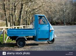 Man Inside A Typical Three Wheels Piaggio Ape Italian Small Pickup ...