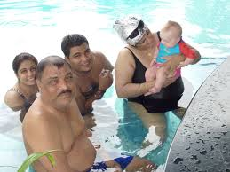Random Indian Family At The Pool Bar Celebrating A Birthday Passing Willow Around For Cuddles And Pinches On Cheek