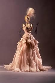 chambre syndicale de la haute couture parisienne théâtre de la mode mannequin with evening dress and accessories