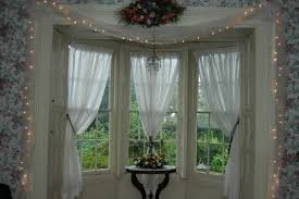 Furniture Cool Dining Room With Curtain Rods For Bay Windows And Chandelier Also Table Chairs