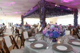 Pink Purple And Blue Flowers In Low Table Arrangement Front Of Dance Floor With Flower