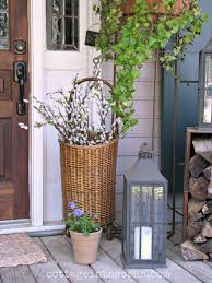 Inexpensive Screened In Porch Decorating Ideas by Spring Front Porch Market Baskets Porch And English