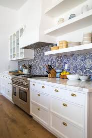 white kitchen with blue mosaic tiles contemporary kitchen