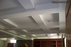 Exposed Basement Ceiling Lighting Ideas by Painted White Color Basement Tray Ceiling Tiles With Concrete Beam