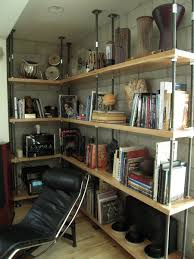 custom made built in metal and reclaimed wood bookcase by mortise