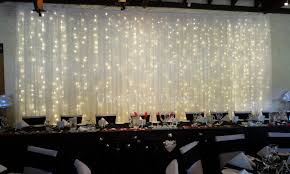 Fairy Twinkle Light Backdrop With Scalloped Black Bridal Table Skirting For Wedding Decorations Hire In