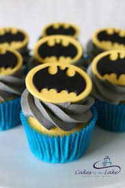 BATMAN CUPCAKES Here is a dozen superhero cupcakes with grey buttercream icing and fondant batman toppers