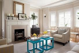 Living Room With Fireplace And Bay Window by Tan Walls With White Trim Living Room Traditional With Turquoise