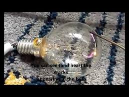cracking a broken light bulb and burning the tungsten wire with