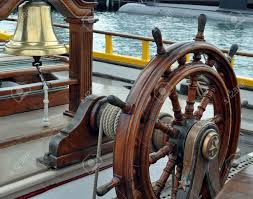 Sailboat Wheel Wall Decor by 8833555 A Sailing Ship S Bell And Wheel Stock Photo Pirate Jpg