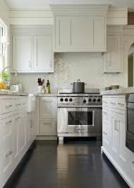 gray shaker kitchen cabinets with stained wood floors and